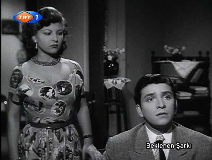 Jeyan Mahfi Ayral, 1953 yapımı Beklenen Şarkı filminde Zeki Müren ile